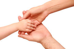 Hand the child in the parents hands Royalty Free Stock Images