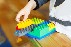 Hand child playing with construction blocks Royalty Free Stock Image