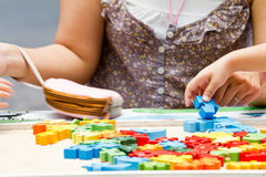 Hand child playing with construction blocks Stock Photos