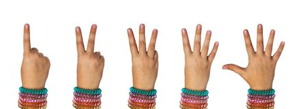 The hand of the child shows the numbers one, two, three, four, five stock photography