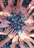 Hand children shape circle on the beach. Royalty Free Stock Image