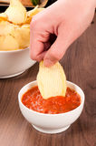 Hand and chips Royalty Free Stock Photography