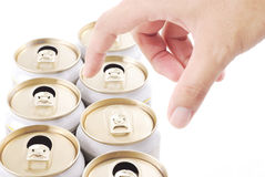 Hand choose un-opened drinks can in row of opened can Royalty Free Stock Photography