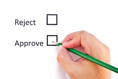 Hand choosing approve. On white paper background Stock Photography