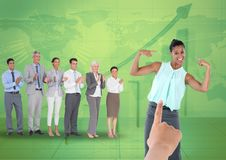 Hand choosing a business woman on green background with graph and business people. Digital composite of Hand choosing a business women on green background with Royalty Free Stock Photos