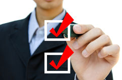 Hand choosing mark the check boxes. Business hand choosing mark the check boxes of many options Stock Photo