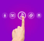 Hand choosing melody-sound film symbol Stock Photo