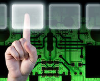 Hand choosing options over technology background. Hand choosing options over black and green technology background Stock Image