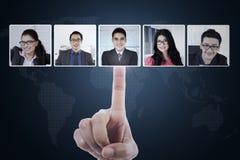 Hand choosing partner on social network Stock Photo