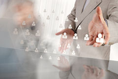 Hand choosing people icon as human resources Stock Images
