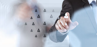 Hand choosing people icon as human resources. Concept Stock Photos