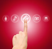 Hand choosing slide film symbol from media icons. On a red background Royalty Free Stock Image