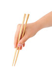 Hand with chopsticks Royalty Free Stock Photography