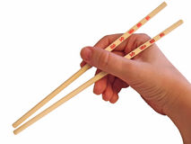 Hand and chopsticks royalty free stock photos
