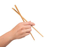 Hand with chopsticks royalty free stock image