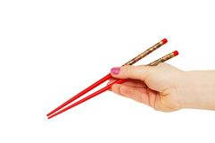 Hand with chopsticks isolated. On the  white Royalty Free Stock Image