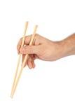 Hand with chopsticks Stock Image