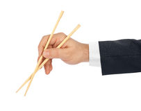Hand with chopsticks Stock Photo