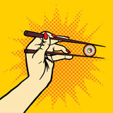 Hand with chopsticks and sushi pop art vector Stock Photography