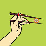 Hand with chopsticks and sushi pop art vector Royalty Free Stock Images