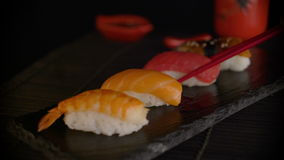 Hand with chopsticks taking sushi. Close-Up view. stock video footage