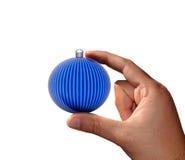Hand with Christmas ball Stock Image
