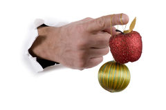 Hand with Christmas decorations Stock Photo