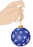 Hand with Christmas decorations Stock Image