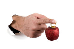 Hand with Christmas decorations macro Stock Photos
