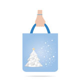 Hand with Christmas shopping bag Royalty Free Stock Photo