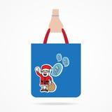 Hand with Christmas shopping bag Stock Photography