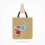 Hand with Christmas shopping bag Royalty Free Stock Image