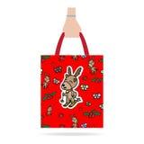 Hand with Christmas shopping bag Stock Image