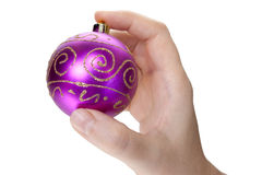 Hand and christmas toy. Decoration isolated on white background Stock Photos