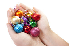 Hand and christmas toy decoration. Isolated on white background Royalty Free Stock Image
