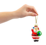 Hand and christmas toy Santa Stock Photography
