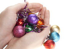 Hand and christmas toys. Decoration isolated on white background Stock Photography