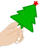 Hand with Christmas tree. The hand that holds the paper Christmas tree on a white background royalty free illustration