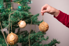 Hand with christmas tree ball decoration Royalty Free Stock Photos