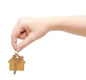 Hand with chrome house key Stock Image