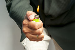 Hand and cigarete lighter Royalty Free Stock Photography