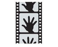 Hand and cinefilm Royalty Free Stock Photos