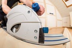 Hand circular saw at work Stock Image