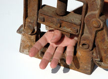 Hand clamped. Pressure on a hand in a clamp royalty free stock photography