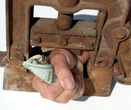 Hand clamped with money Royalty Free Stock Photo