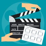 Hand with clapperboard Stock Photos