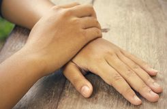 Hand Clasp. Thinking, worry, tension, anticipation, restlessness and comfortable Stock Images