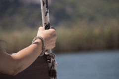 A hand clasping the mast Royalty Free Stock Photos