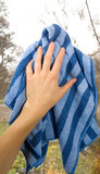 Hand with clean dishrag. On window Royalty Free Stock Photography