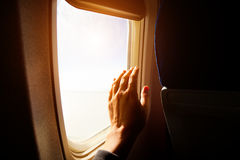 Hand Cleaning an Aeroplane Window Stock Photography